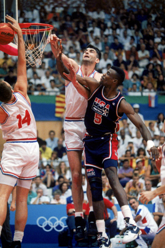 "BARCELONA, SPAIN - JULY 27:  David Robinson #5 of the United States goes up for a rebound against Stojan Vrankovic #11 and Dino Radja #14 of Croatia during the 1992 Olympic game against Croatia on July 27, 1992 in Barcelona, Spain. The ""Dream Team"" defeated Croatia 103-70. NOTE TO USER: User expressly acknowledges and agress that, by downloading and or using this photograph, User is consenting to the terms and conditions of the Getty Images License Agreement. (Photo by Mike Powell/Getty Images)"
