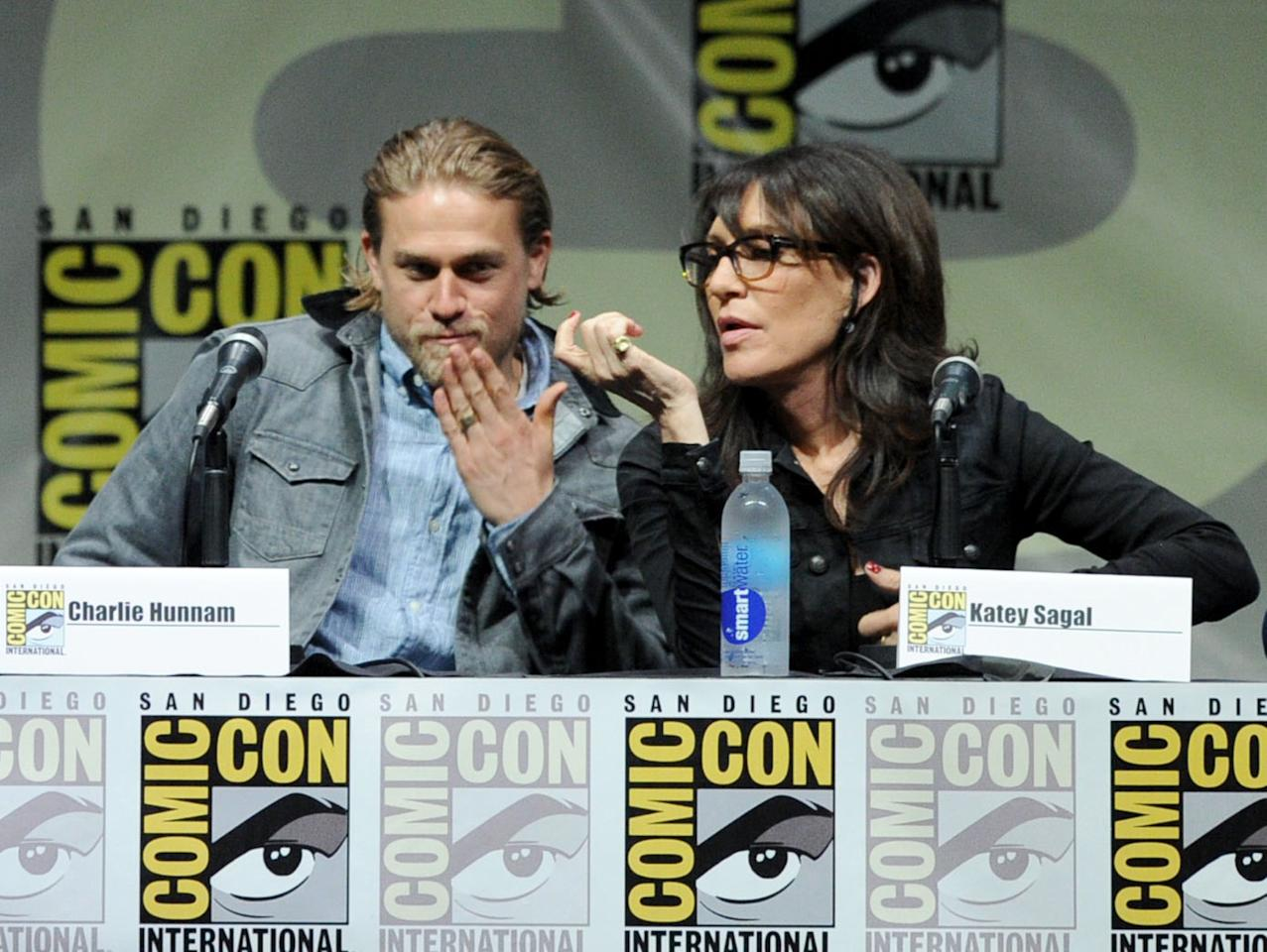 """SAN DIEGO, CA - JULY 21: Actors Charlie Hunnam (L) and Katey Sagal speak onstage at the """"Sons Of Anarchy"""" panel during Comic-Con International 2013 at San Diego Convention Center on July 21, 2013 in San Diego, California. (Photo by Kevin Winter/Getty Images)"""