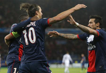Paris St-Germain's Ibrahimovic celebrates with team mates after scoring his team's first goal during their Champions League soccer match against Anderlecht at the Parc des Princes Stadium in Paris