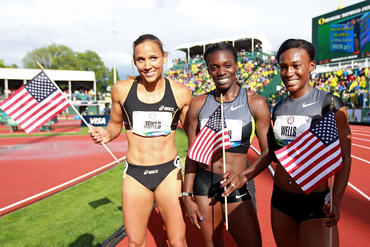 EUGENE, OR - JUNE 23:  (L-R) Lolo Jones, Dawn Harper and Kellie Wells pose after qualifying for the Olympics after the women's 100 meter hurdles final during Day Two of the 2012 U.S. Olympic Track & Field Team Trials at Hayward Field on June 23, 2012 in Eugene, Oregon.  (Photo by Andy Lyons/Getty Images)
