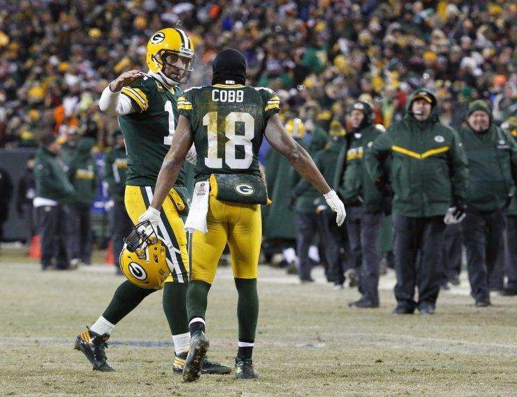 Aaron Rodgers threw four touchdowns against the Giants, three to Randall Cobb. (AP)