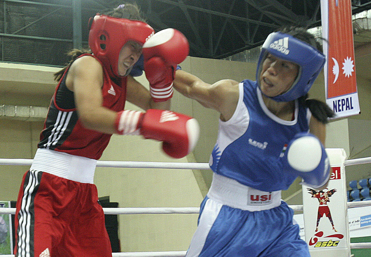 In this Sept. 25, 2008, file photo, India's M.C. Mary Kom, right, delivers a punch to Boranbayeva of Kazakhstan during the 46kg quarterfinal match at the 4th Asian Women's Boxing Championship in Gauhati, India. The 29-year-old Kom, who has two children, says she is in her best form and has a good chance of winning a medal at the 2012 Olympics. (AP Photo/Anupam Nath, File)