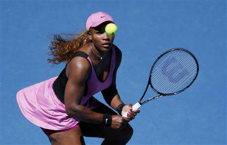 Serena Williams of the U.S. eyes the ball during her women's singles match against Daniela Hantuchova of Slovakia at the Australian Open 2014 tennis tournament in Melbourne