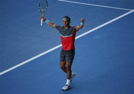 Rafael Nadal of Spain celebrates defeating Grigor Dimitrov of Bulgaria in their men's singles quarter-final tennis match at the Australian Open 2014 tennis tournament in Melbourne