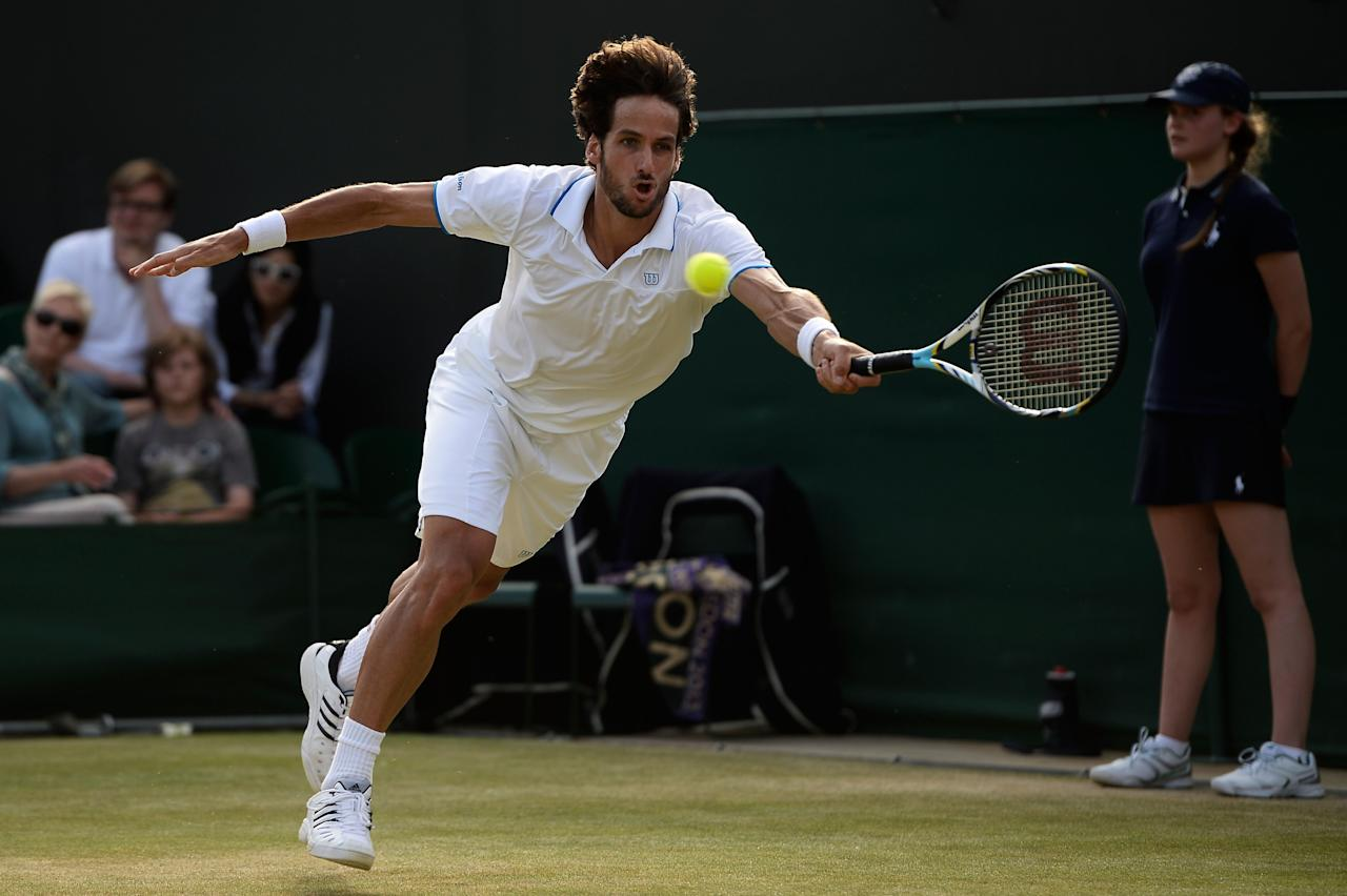 LONDON, ENGLAND - JUNE 29: Feliciano Lopez of Spain plays a forehand during the Gentlemen's Singles third round match against Tommy Haas of Germany on day six of the Wimbledon Lawn Tennis Championships at the All England Lawn Tennis and Croquet Club on June 29, 2013 in London, England. (Photo by Dennis Grombkowski/Getty Images)