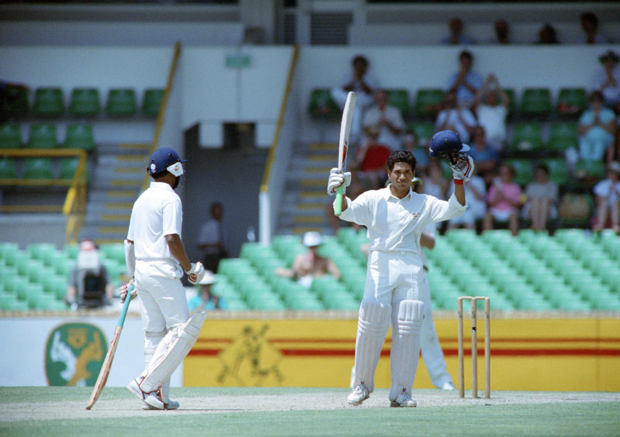 Indian batsman Sachin Tendulkar raises his bat after making a century, on february 3, 1992, during a match against Australia, in Perth. (Photo credit should read GREG WOOD/AFP/Getty Images)