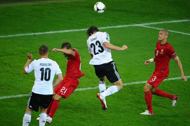 L'VIV, UKRAINE - JUNE 09:  Mario Gomez of Germany scores their first goal during the UEFA EURO 2012 group B match between Germany and Portugal at Arena Lviv on June 9, 2012 in L'viv, Ukraine.  (Photo by Laurence Griffiths/Getty Images)