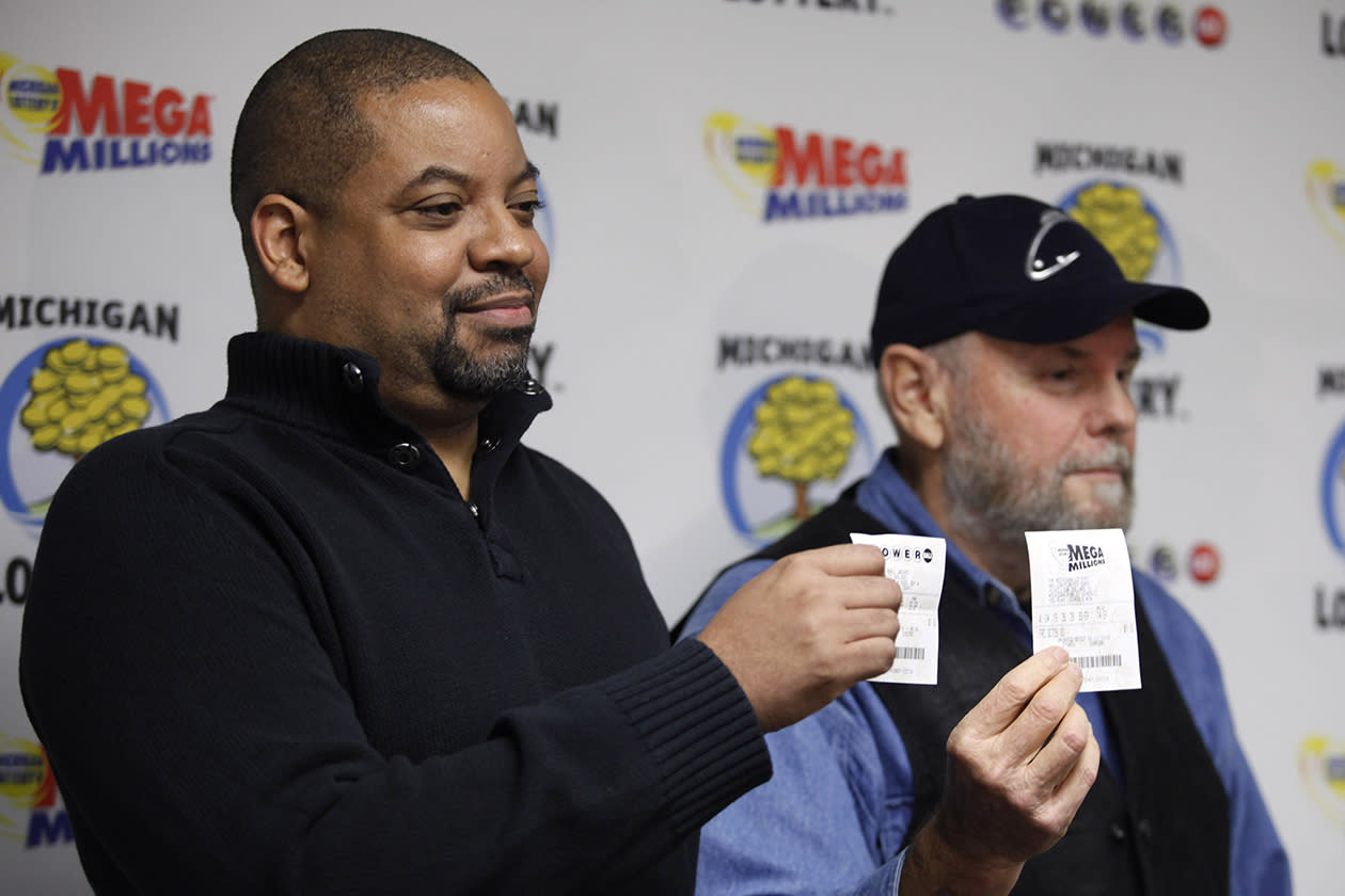 "<b>$129 million</b><br><br>Mike Greer, left, of Farmington Hills, Mich., a representative of the ""Team Victory"" lottery club, and Steve Mays, of Gladstone, Mich., hold their winning lottery tickets during a news conference Friday, Nov. 12, 2010, in Lansing, Mich. A $129 million Powerball lottery ticket sold at an urban porn shop is being split by members of a group primarily from southeast Michigan. Separately, Steve Mays of Gladstone, Mich., came forward to claim a Mega Millions jackpot worth $141 million. The retiree, who wouldn't disclose his age, bought the ticket at a convenience store. He said he hasn't decided what to do with his winnings, which he will take in 26 annual installments of $5.4 million."