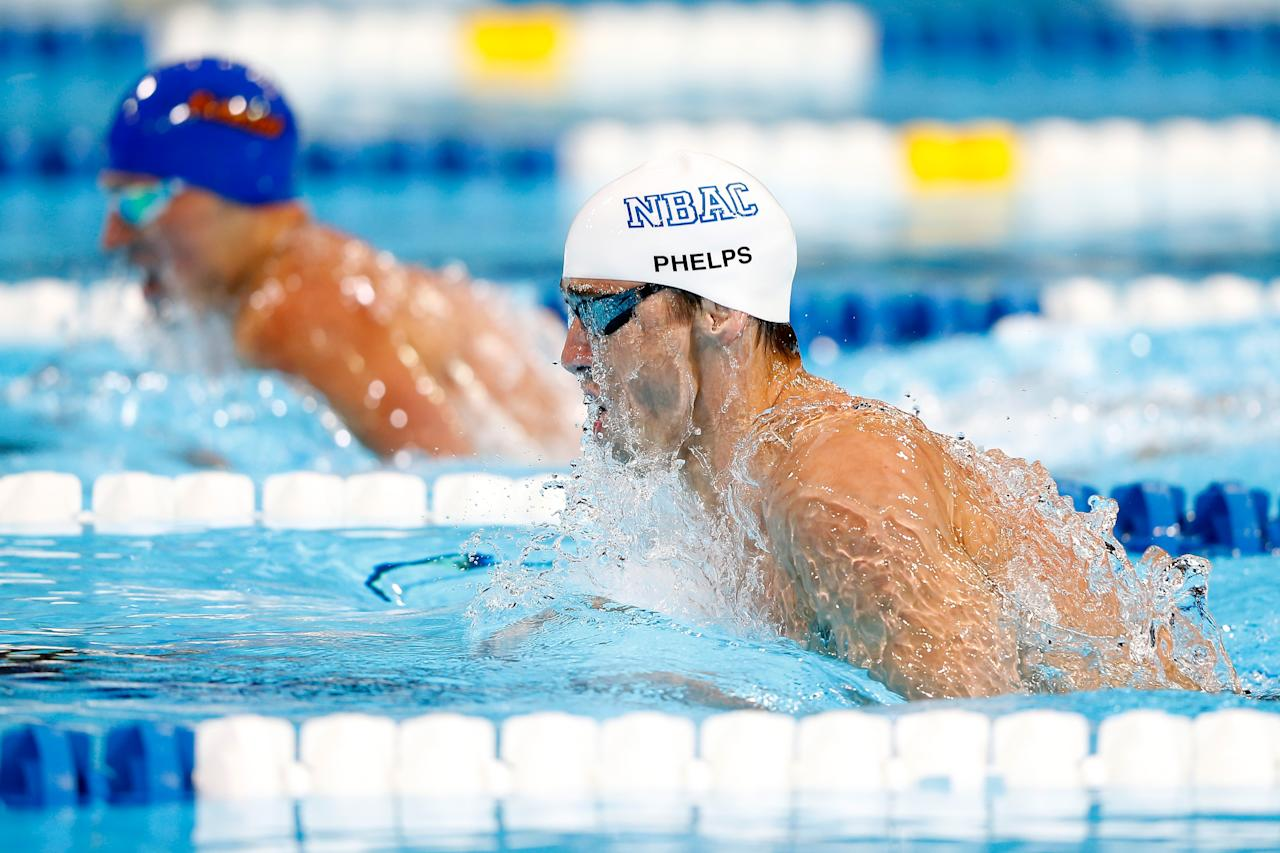 Ryan Lochte and Michael Phelps (white cap) compete against each other in the championship final of the Men's 200 m Individual Medley during Day Six of the 2012 U.S. Olympic Swimming Team Trials at CenturyLink Center on June 30, 2012 in Omaha, Nebraska. (Photo by Jamie Squire/Getty Images)