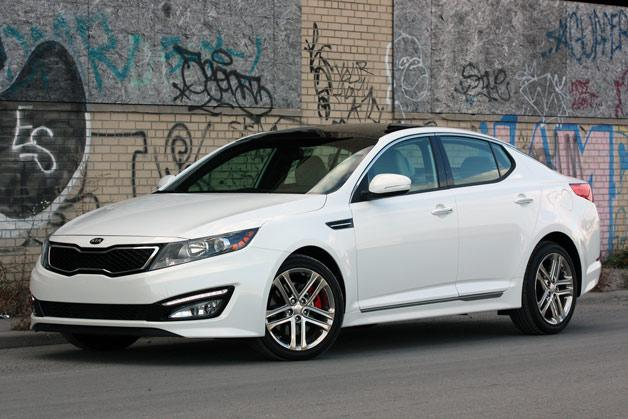 "<p style=""text-align:right;"">  <b><a href=""http://ca.autos.yahoo.com/kia/optima/2013/"" target=""_blank"">2013 Kia Optima 4dr Sdn Auto EX</a></b><br>  <b>TOTAL SAVINGS $3,840</b><br>  <a href=""http://www.unhaggle.com/yahoo/"" target=""_blank""><img src=""http://www.unhaggle.com/static/uploads/logo.png""></a>  <a href=""http://www.unhaggle.com/dealer-cost/report/form/?year=2013&make=Kia&model=Optima&style_id=354277"" target=""_blank""><img src=""http://www.unhaggle.com/static/uploads/getthisdeal.png""></a><br>  </p>  <div style=""text-align:right;"">  <br><b>Manufacturer Suggested Retail Price</b>:  <b>$26,795</b>  <br><br><a href=""http://www.unhaggle.com/Kia/Optima/2013/Incentives/"" target=""_blank"">Kia Canada Incentive</a>*: $3,000  <br>Unhaggle Savings: $840  <br><b>Total Savings: $3,840</b>  <br><br>Mandatory Fees (Freight, Govt. Fees): $1,590  <br><b>Total Before Tax: $24,545</b>  </div>  <br><br><p style=""font-size:85%;color:#777;"">  * Manufacturer incentive displayed is for cash purchases and may differ if leasing or financing. For more information on purchasing any of these vehicles or others, please visit <a href=""http://www.unhaggle.com"" target=""_blank"">Unhaggle.com</a>. While data is accurate at time of publication, pricing and incentives may be updated or discontinued by individual dealers or manufacturers at any time. Vehicle availability is also subject to change based on market conditions. Unhaggle Savings is a proprietary estimate of expected discount in addition to manufacturer incentive based on actual savings by Unhaggle customers  </p>"