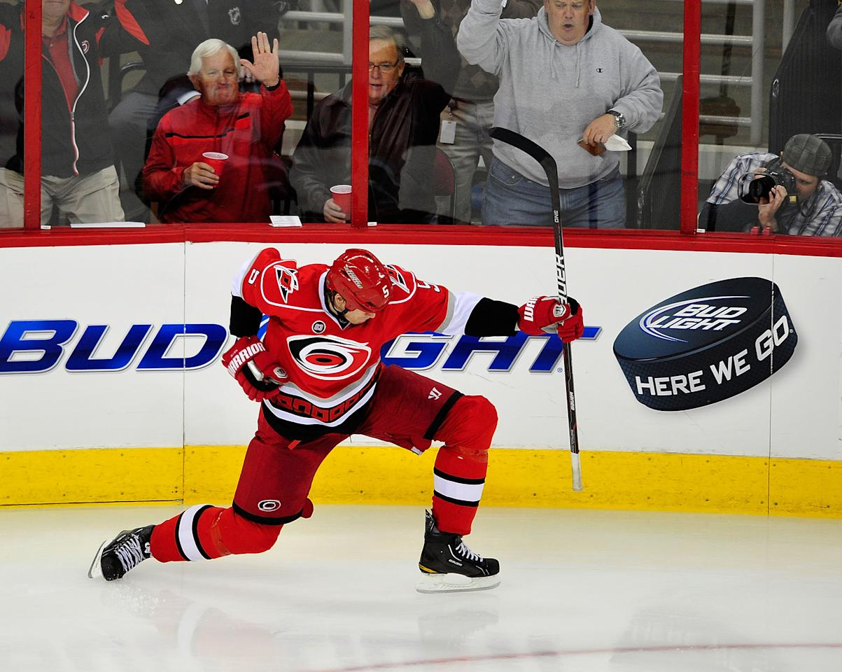 RALEIGH, NC - FEBRUARY 28:  Bryan Allen #5 of the Carolina Hurricanes celebrates after scoring the game-winning goal against the Nashville Predators during the third period at the RBC Center on February 28, 2012 in Raleigh, North Carolina. The Hurricanes won 4-3.  (Photo by Grant Halverson/Getty Images)
