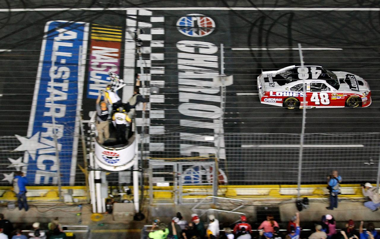 CHARLOTTE, NC - MAY 19:  Jimmie Johnson, driver of the #48 Lowe's Patriotic Chevrolet, crosses the finish line to win the NASCAR Sprint All-Star Race at Charlotte Motor Speedway on May 19, 2012 in Charlotte, North Carolina.  (Photo by Streeter Lecka/Getty Images)