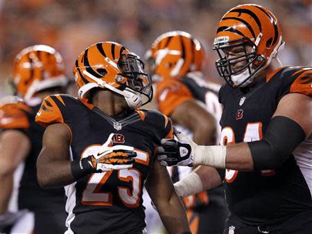 Bengals' Bernard celebrates his touchdown against the Steelers with Cook during the first half of play in their NFL football game at Paul Brown Stadium in Cincinnati
