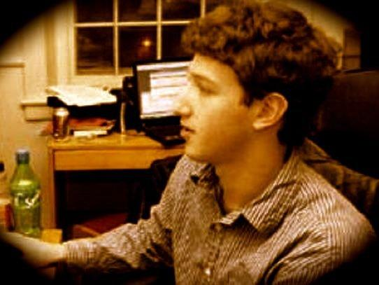 Young Mark Zuckerberg in sepia tones