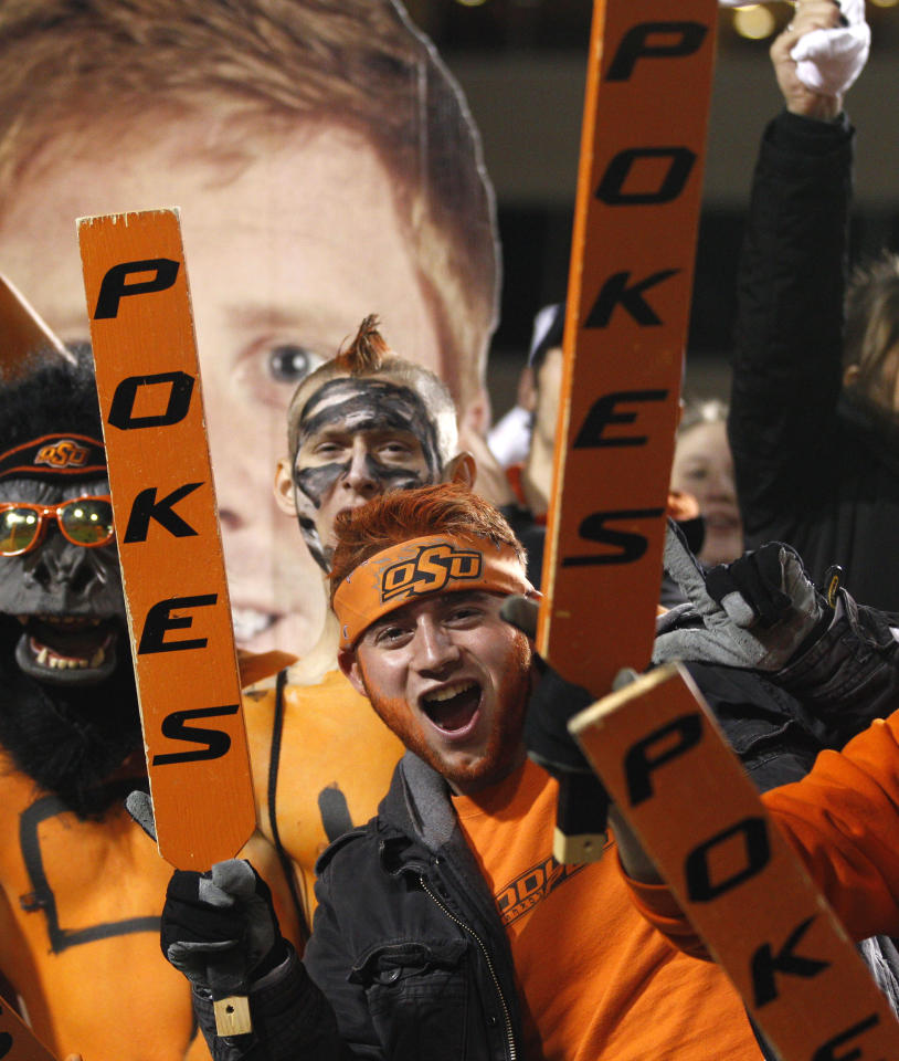 Jared Martin, a sophomore from Tulsa, Okla., cheers before the Oklahoma and Oklahoma State NCAA college football game in Stillwater, Okla., Saturday, Dec. 3, 2011. (AP Photo/Sue Ogrocki)
