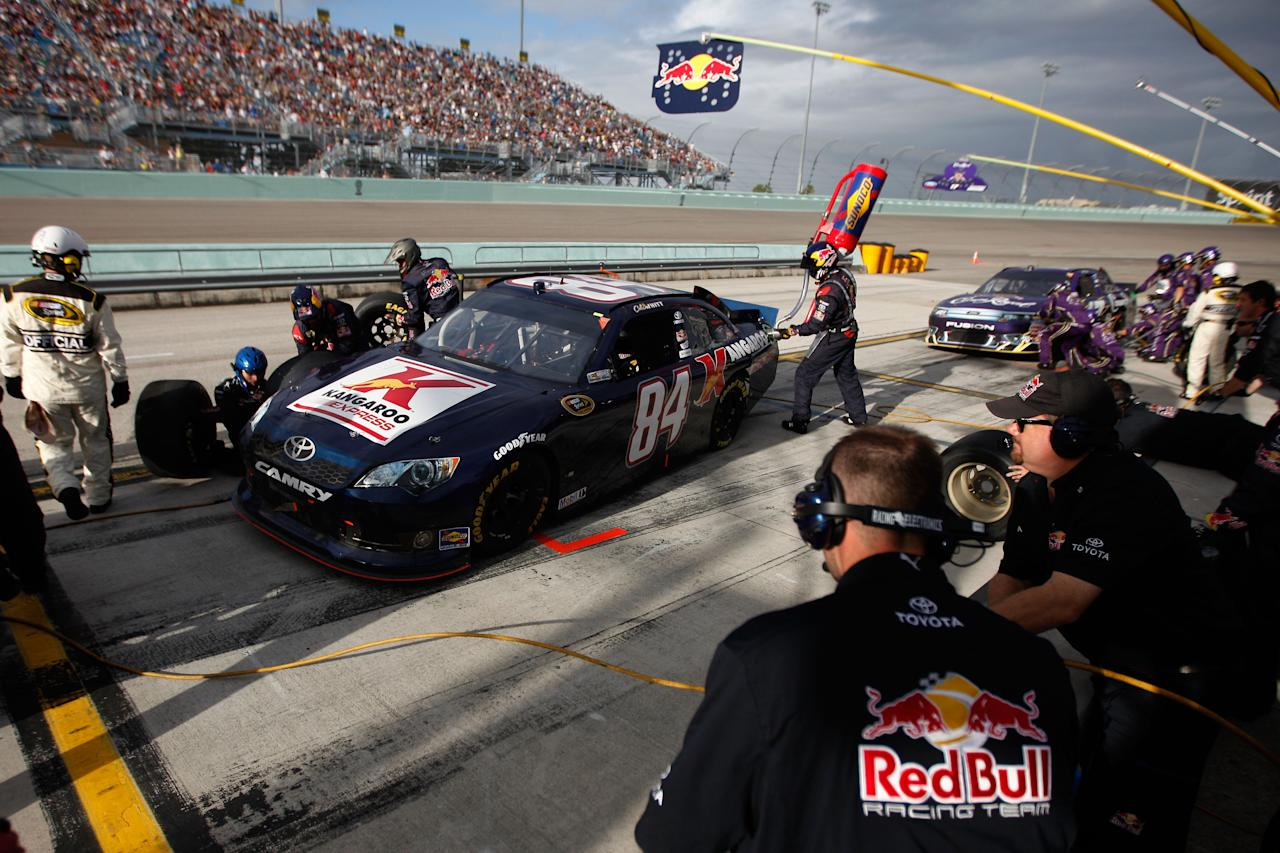HOMESTEAD, FL - NOVEMBER 20:  Cole Whitt, driver of the #84 Red Bull Racing Team Toyota, pits during the NASCAR Sprint Cup Series Ford 400 at Homestead-Miami Speedway on November 20, 2011 in Homestead, Florida.  (Photo by Chris Graythen/Getty Images)