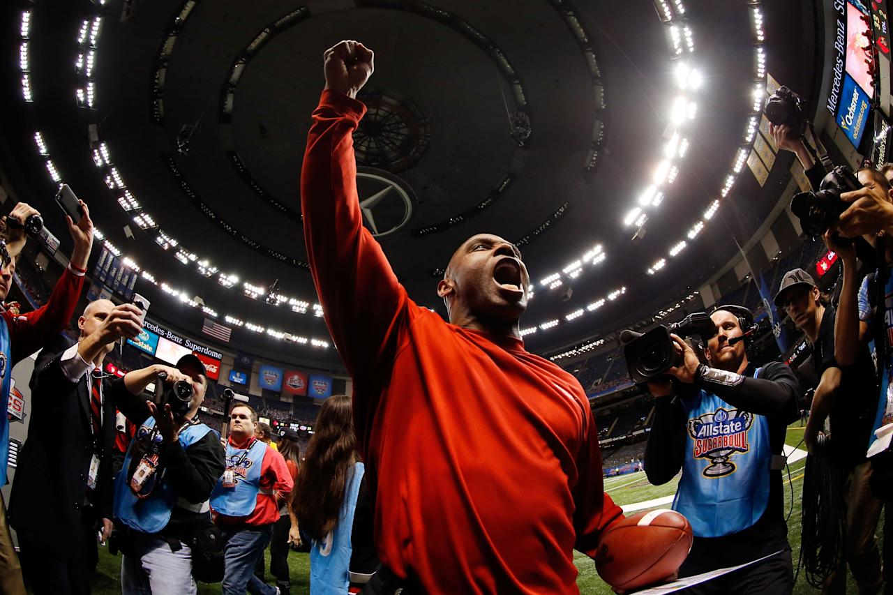 NEW ORLEANS, LA - JANUARY 02:  Head coach Charlie Strong of the Louisville Cardinals celebrates after they defeated the Florida Gators 33 to 23 in the Allstate Sugar Bowl at Mercedes-Benz Superdome on January 2, 2013 in New Orleans, Louisiana.  (Photo by Chris Graythen/Getty Images)