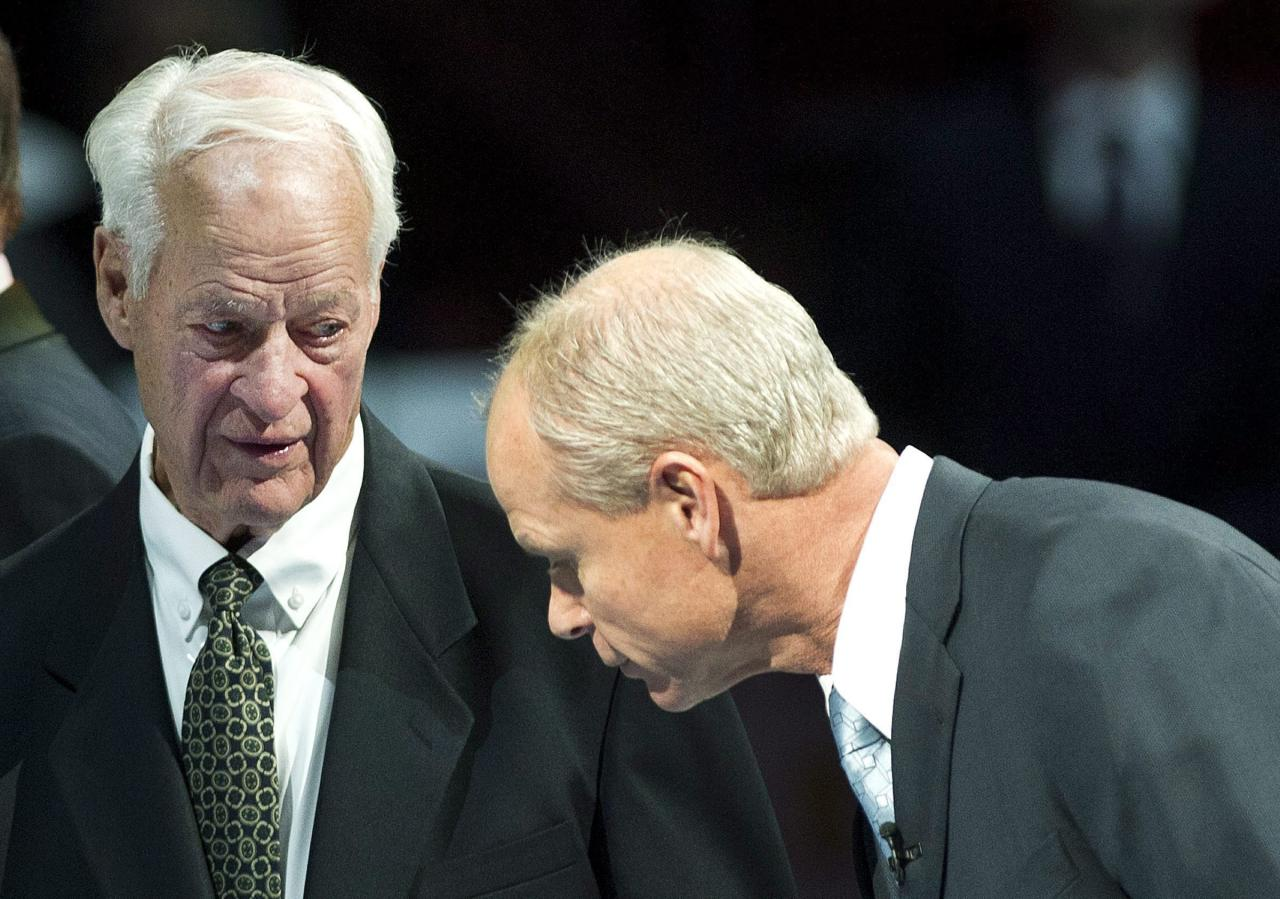 In this Nov. 12, 2011 photo, Hockey Hall of Fame inductee Mark Howe, right, talks to his father Gordie Howe, left, as they take part in a ceremony before the Toronto Maple Leafs and Ottawa Senators NHL game in Toronto. At 83, Mr. Hockey is still in demand and on the move. Gordie Howe is about to embark on another series of fundraisers for research into dementia. It's a personal cause. The disease killed his wife Colleen in 2009 and is beginning to affect him. (AP Photo/The Canadian Press, Nathan Denette)
