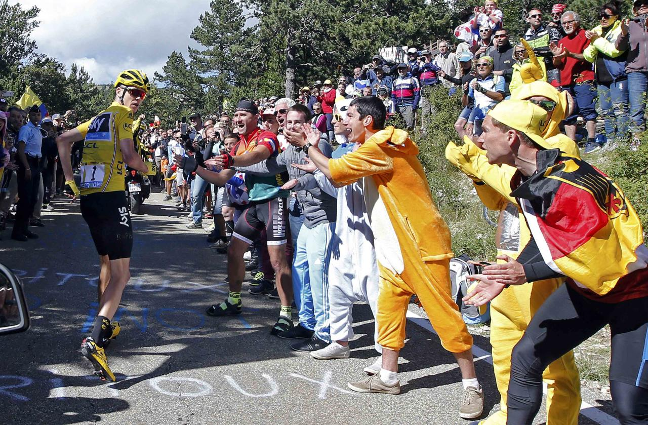 France's LCL/UJSF 2016 photo contest winning picture shows yellow jersey leader Team Sky rider Chris Froome of Britain running on the road after a fall during the Tour de France cycling race stage 12 from Montpellier to Chalet-Reynard, France, July 14, 2016. Picture taken July 14, 2016.   REUTERS/Jean-Paul Pelissier  TPX IMAGES OF THE DAY