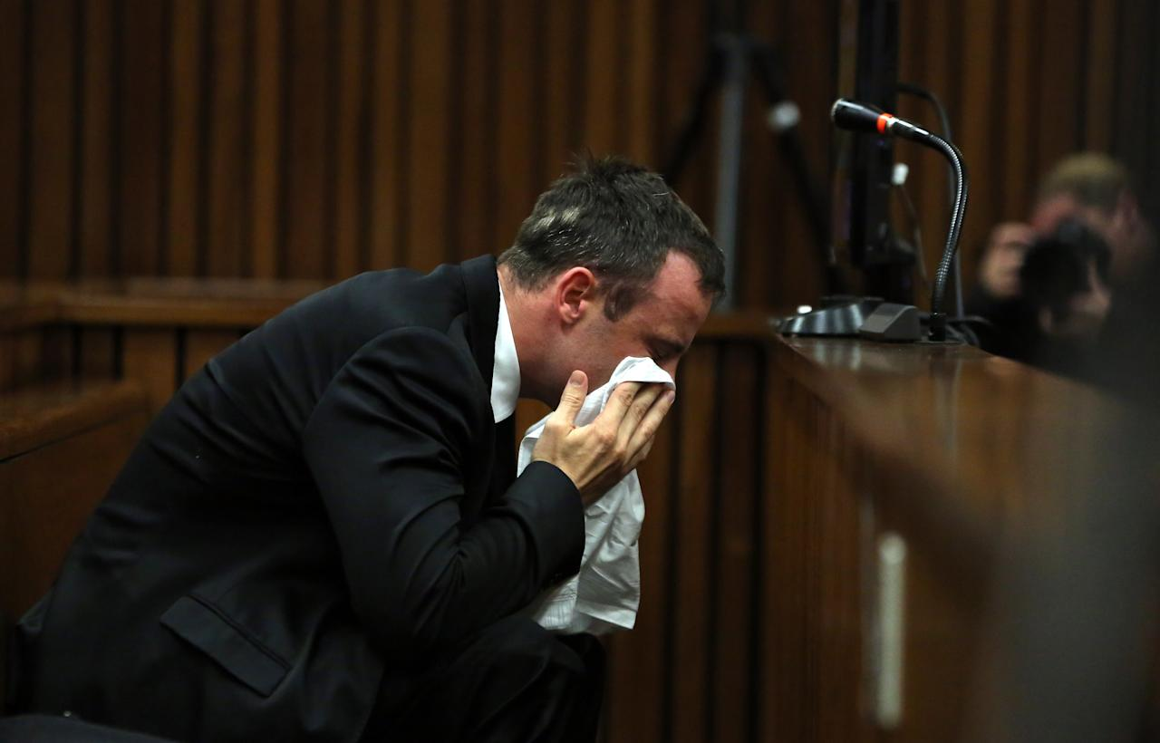 Oscar Pistorius weeps as he listens to evidence by a pathologist in court in Pretoria, South Africa, Monday, April 7, 2014. Pistorius is charged with murder for the shooting death of his girlfriend Reeva Steenkamp, on Valentines Day 2013. (AP Photo/Themba Hadebe, Pool)