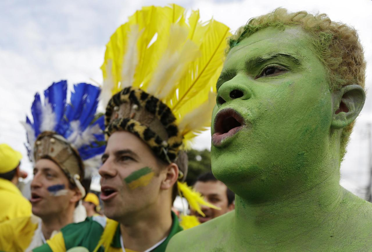 Brazil supporters arrive at the Mineirao Stadium for the World Cup semifinal soccer match between Brazil and Germany in Belo Horizonte, Brazil, Tuesday, July 8, 2014. (AP Photo/Natacha Pisarenko)