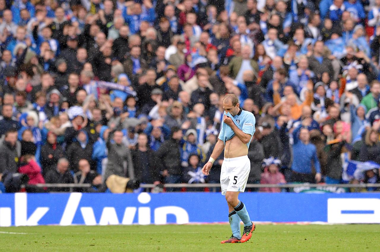 Manchester City's Pablo Zabaleta stands dejected after he is sent off for a second bookeable offence, following a challenge on Wigan Athletic's Callum McManaman