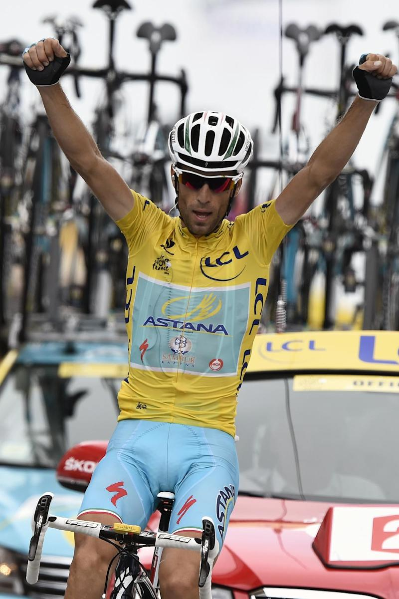 Italy's Vincenzo Nibali celebrates as he crosses the finish line at the end of the 18th stage of the 101st edition of the Tour de France between Pau and Hautacam, on July 24, 2014