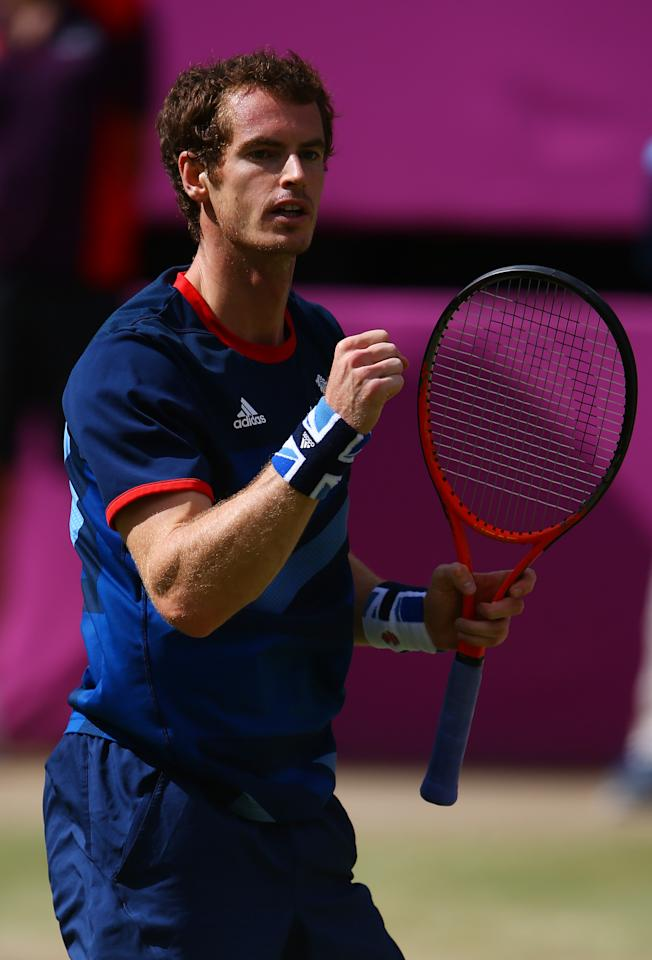 LONDON, ENGLAND - AUGUST 05:  Andy Murray of Great Britain reacts after a point against Roger Federer of Switzerland during the Men's Singles Tennis Gold Medal Match on Day 9 of the London 2012 Olympic Games at the All England Lawn Tennis and Croquet Club on August 5, 2012 in London, England.  (Photo by Paul Gilham/Getty Images)