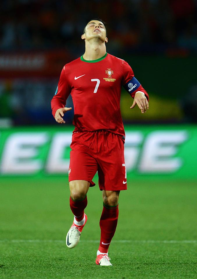 KHARKOV, UKRAINE - JUNE 17:  Cristiano Ronaldo of Portugal reacts during the UEFA EURO 2012 group B match between Portugal and Netherlands at Metalist Stadium on June 17, 2012 in Kharkov, Ukraine.  (Photo by Lars Baron/Getty Images)