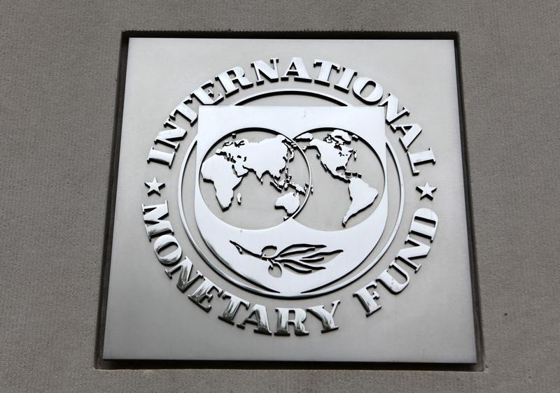 The International Monetary Fund (IMF) logo is seen at the IMF headquarters building during the 2013 Spring Meeting of the International Monetary Fund and World Bank in Washington