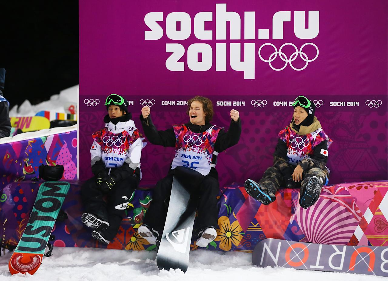 SOCHI, RUSSIA - FEBRUARY 11: (L-R) Ayumu Hirano of Japan, Iouri Podladtchikov of Switzerland and Taku Hiraoka of Japan celebrate after competing in the Snowboard Men's Halfpipe Finals on day four of the Sochi 2014 Winter Olympics at Rosa Khutor Extreme Park on February 11, 2014 in Sochi, Russia. (Photo by Al Bello/Getty Images)