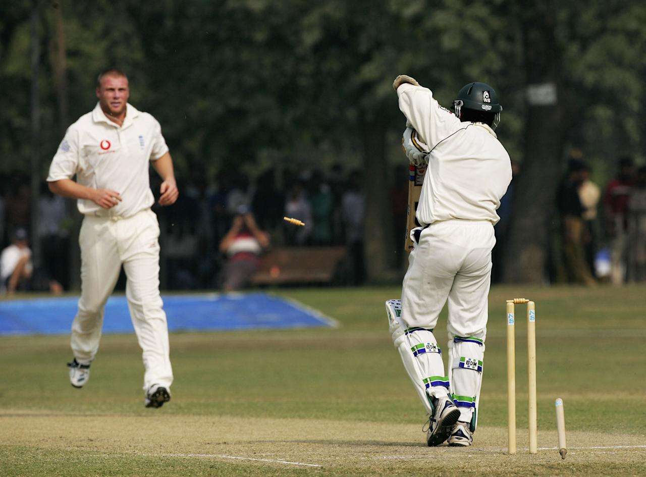 LAHORE, PAKISTAN - NOVEMBER 8:  England bowler Andrew Flintoff takes the wicket of Pakistan batsman Shahid Nazir for 43 runs during the Third and final day of the game against Pakistan 'A'  at Bagh-E-Jinnah on November 8, 2005 in Lahore, Pakistan. (Photo by Stu Forster/Getty Images)