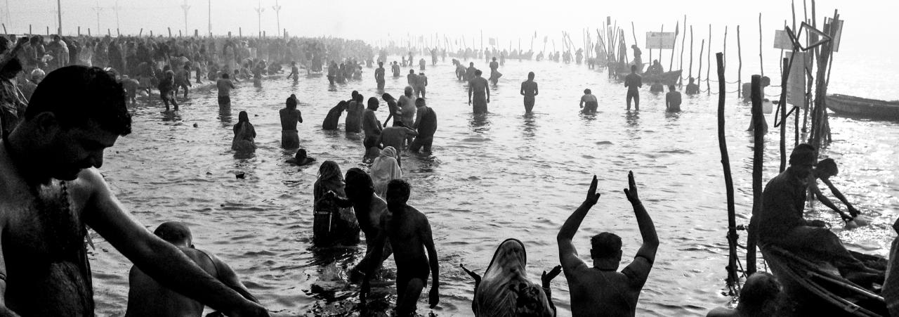 ALLAHABAD, INDIA - JANUARY 15: (EDITORS NOTE: Image was created using the iPhone panoramic application) Hindu devotees bathe in the waters of Sangam, the confluence of the holy rivers Ganges, Yamuna and the mythical Saraswati, during the Maha Kumbh Mela on January 15, 2013 in Allahabad, India. The Maha Kumbh Mela, believed to be the largest religious gathering on earth is held every 12 years on the banks of Sangam, the confluence of the holy rivers Ganga, Yamuna and the mythical Saraswati. The Kumbh Mela alternates between the cities of Nasik, Allahabad, Ujjain and Haridwar every three years. The Maha Kumbh Mela celebrated at the holy site of Sangam in Allahabad, is the largest and holiest, celebrated over 55 days, it is expected to attract over 100 million people. (Photo by Daniel Berehulak/Getty Images)