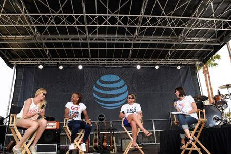 Jul 23, 2016; Los Angeles, CA, USA; American swimmer Janet Evans (right) talks to volleyball player Kerri Walsh-Jennings (left) and basketball player Tamika Catchings  (second from left) and water polo player Tony Azevedo (second from right) during the Team USA Road to Rio tour announcement show at Venice Beach. Mandatory Credit: Kelvin Kuo-USA TODAY Sports