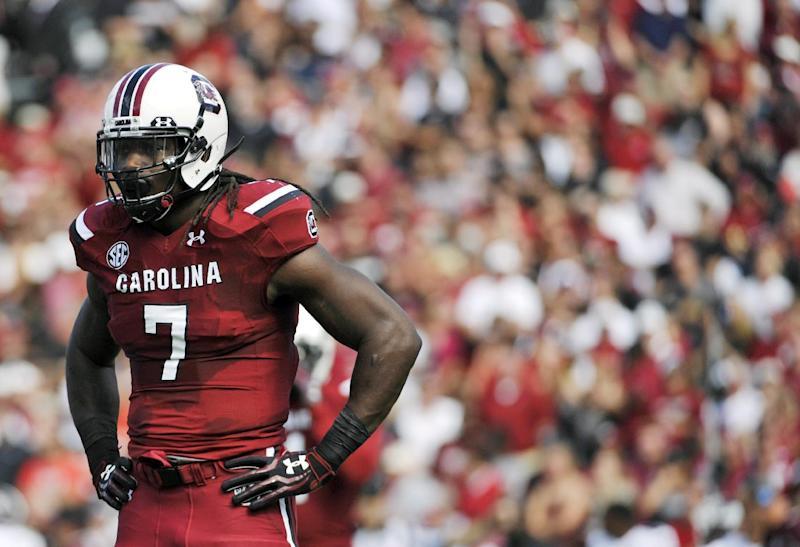 In this Nov. 2, 2013, file photo, South Carolina's Jadeveon Clowney looks to the sidelines between plays in the first half of an NCAA college football game against Mississippi State in Columbia, S.C.  The Houston Texans hold the No. 1 overall pick in a draft in which  Clowney is widely considered the best player available. Pairing him with J.J. Watt could give Houston the best 1-2 pass-rushing combination in the NFL