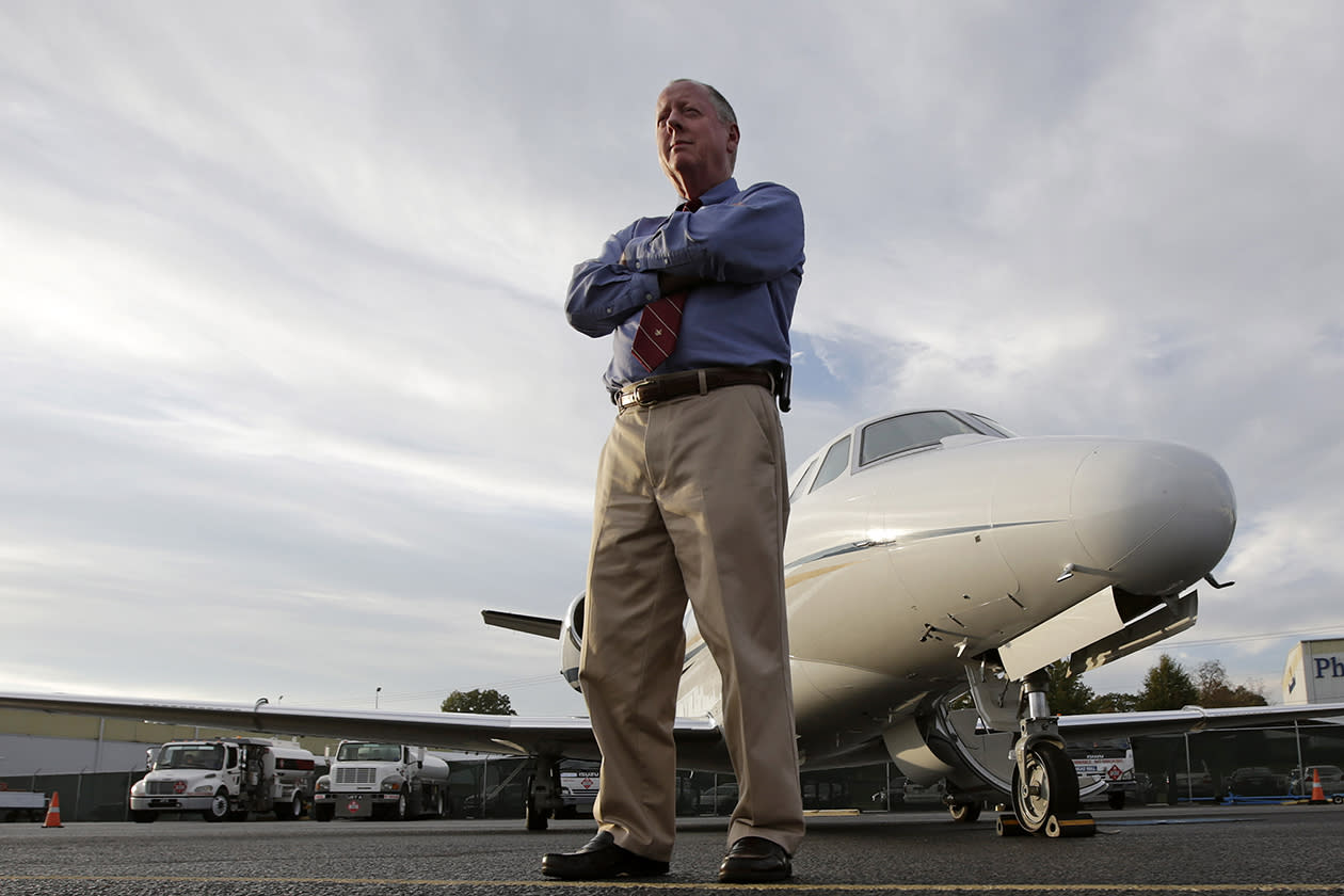 "Harvey Martin, a pilot, at the Birmingham Shuttlesworth International Airport in Birmingham, Ala. For 14 months, Martin lived in belt-tightening mode. No new car, no travel, no bolstering his savings, no stock purchases. The corporate pilot lost his job when the Birmingham, Ala., bank where he worked was sold, and the new owners closed the flight department in late 2010. Martin was 55, financially secure, not needing a new job, but definitely wanting one. ""When you lose a job through no fault of your own, it's some consolation,"" he says. ""But that's not much help when you're going to the grocery store."""