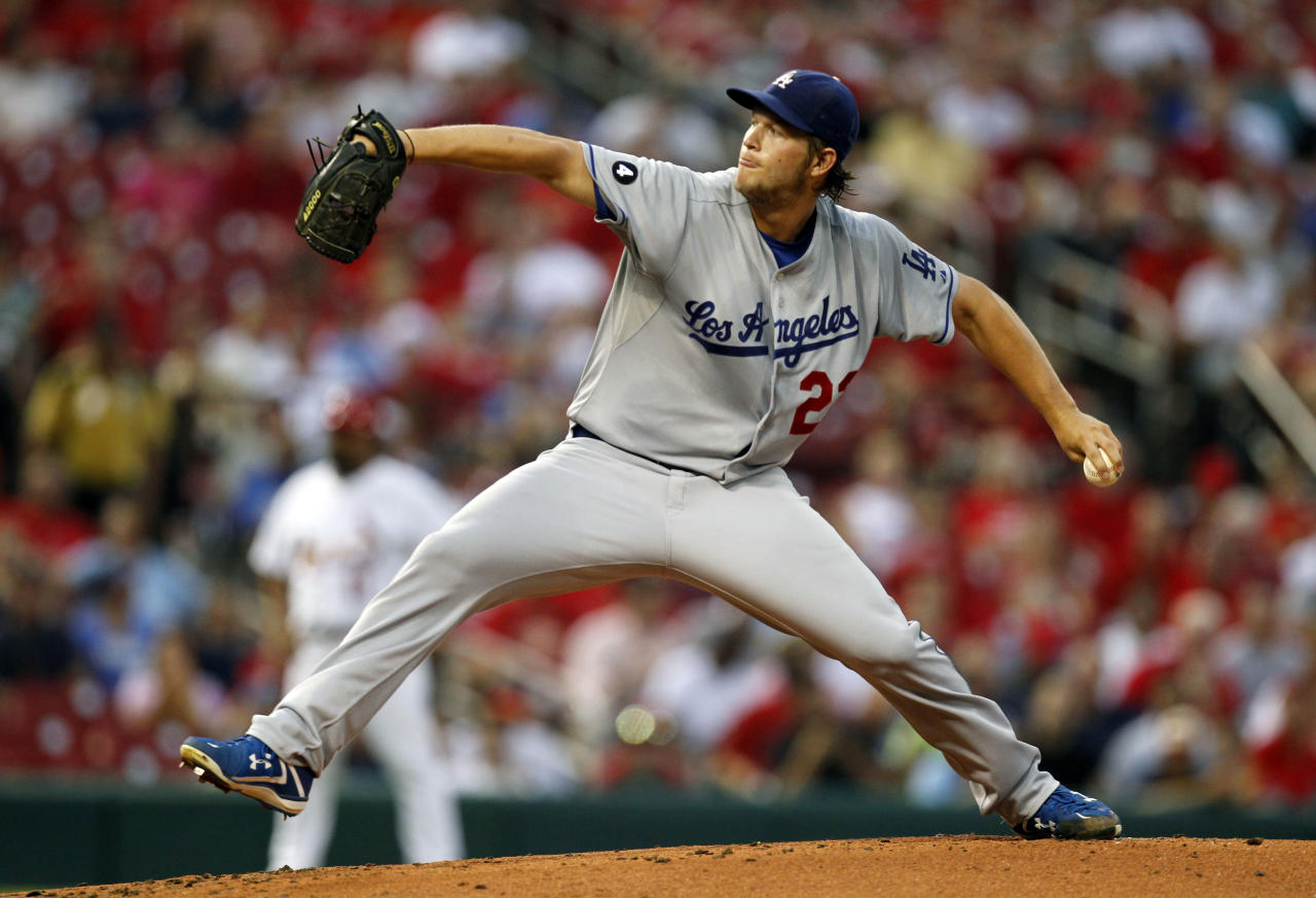 FILE - In this Aug. 23, 2011 file photo, Los Angeles Dodgers starting pitcher Clayton Kershaw throws during the first inning of a baseball game against the St. Louis Cardinals, in St. Louis. Kershaw won the National League Cy Young Award in voting announced Thursday, Nov. 17, 2011. (AP Photo/Jeff Roberson, File)