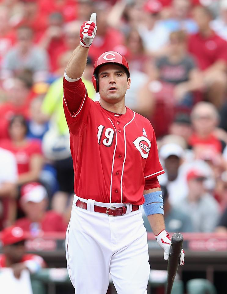 CINCINNATI, OH - JUNE 16: Joey Votto #19 of the Cincinnati Reds signals to the stands after a fan was hit by a foul ball hit Votto during the game against the Milwaukee Brewers at Great American Ball Park on June 16, 2013 in Cincinnati, Ohio. (Photo by Andy Lyons/Getty Images)