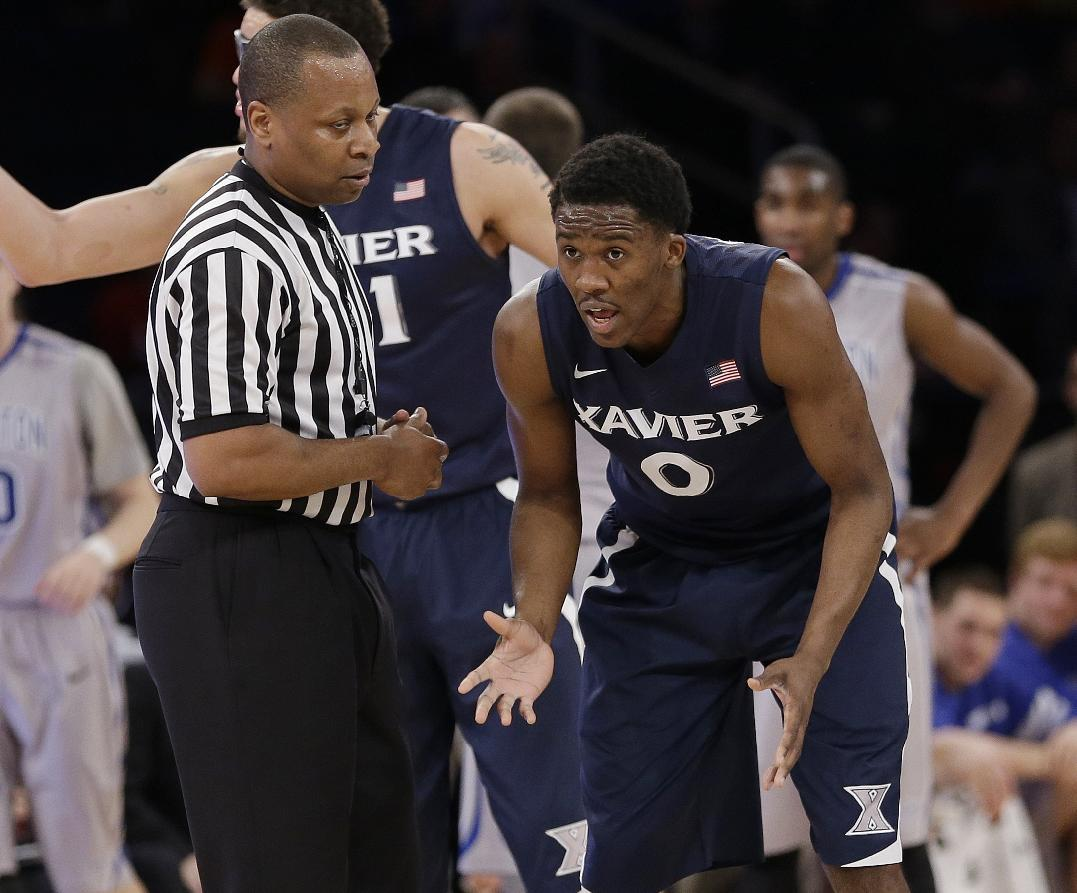 Xavier's Semaj Christon (0) argues a call with the referee during the first half of an NCAA college basketball game against Creighton in the semifinals of the Big East Conference tournament Friday, March 14, 2014, at Madison Square Garden in New York. (AP Photo/Frank Franklin II)