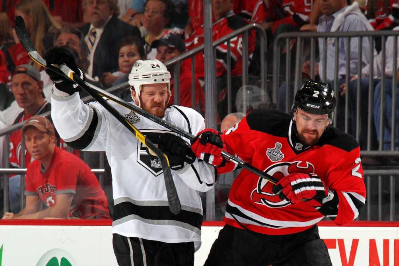 NEWARK, NJ - MAY 30: Colin Fraser #24 of the Los Angeles Kings and Marek Zidlicky #2 of the New Jersey Devils fight for position during Game One of the 2012 NHL Stanley Cup Final at the Prudential Center on May 30, 2012 in Newark, New Jersey.  (Photo by Bruce Bennett/Getty Images)