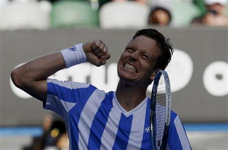 Tomas Berdych of the Czech Republic celebrates defeating David Ferrer of Spain in their men's singles quarter-final tennis match at the Australian Open 2014 tennis tournament in Melbourne