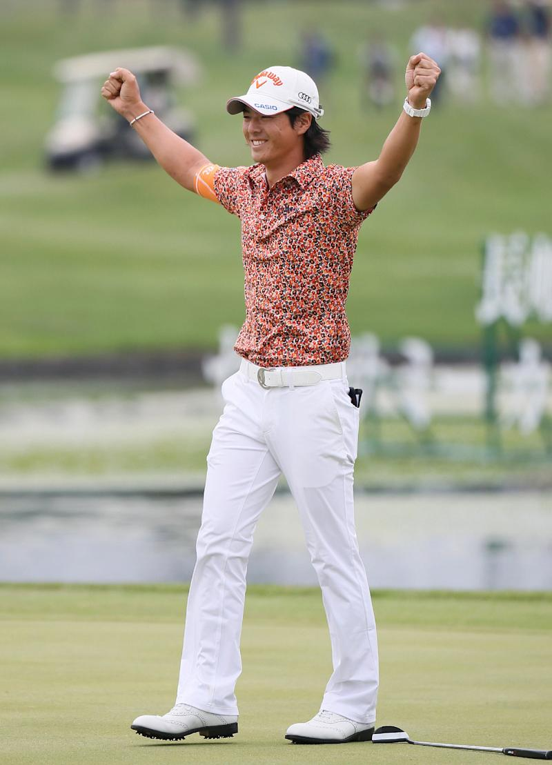 Japanese golfer Ryo Ishikawa reacts just after sinking the birdie putt during the play-off with Komei Oda in the Sega Sammy Cup golf tournament in Chitose, Hokkaido Prefecture, on July 6, 2014