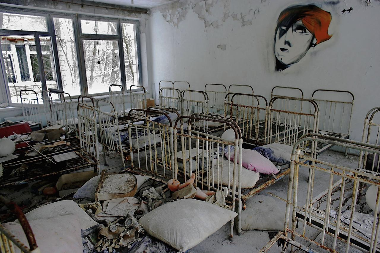 (FILE PHOTO) April 26 will mark 25 years since the world's worst nuclear disaster at the Chernobyl power plant in the Ukraine.  Please refer to the following profile on Getty Images Archival for further archival imagery.    http://www.gettyimages.co.uk/Search/Search.aspx?EventId=109853078&EditorialProduct=Archival#  CHERNOBYL - JANUARY 25: The remnants of beds are seen in an abandoned in a pre school in the deserted town of Pripyat on January 25, 2006 in Chernobyl, Ukraine. Prypyat and the surrounding area will not be safe for human habitation for several centuries. Scientists estimate that the most dangerous radioactive elements will take up to 900 years to decay sufficiently to render the area safe.  (Photo by Daniel Berehulak/Getty Images)