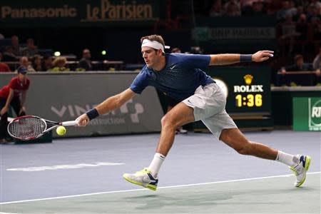 Del Potro of Argentina stretches to return to Cilic of Croatia at the Paris Masters men's singles tennis tournament at the Palais Omnisports of Bercy in Paris