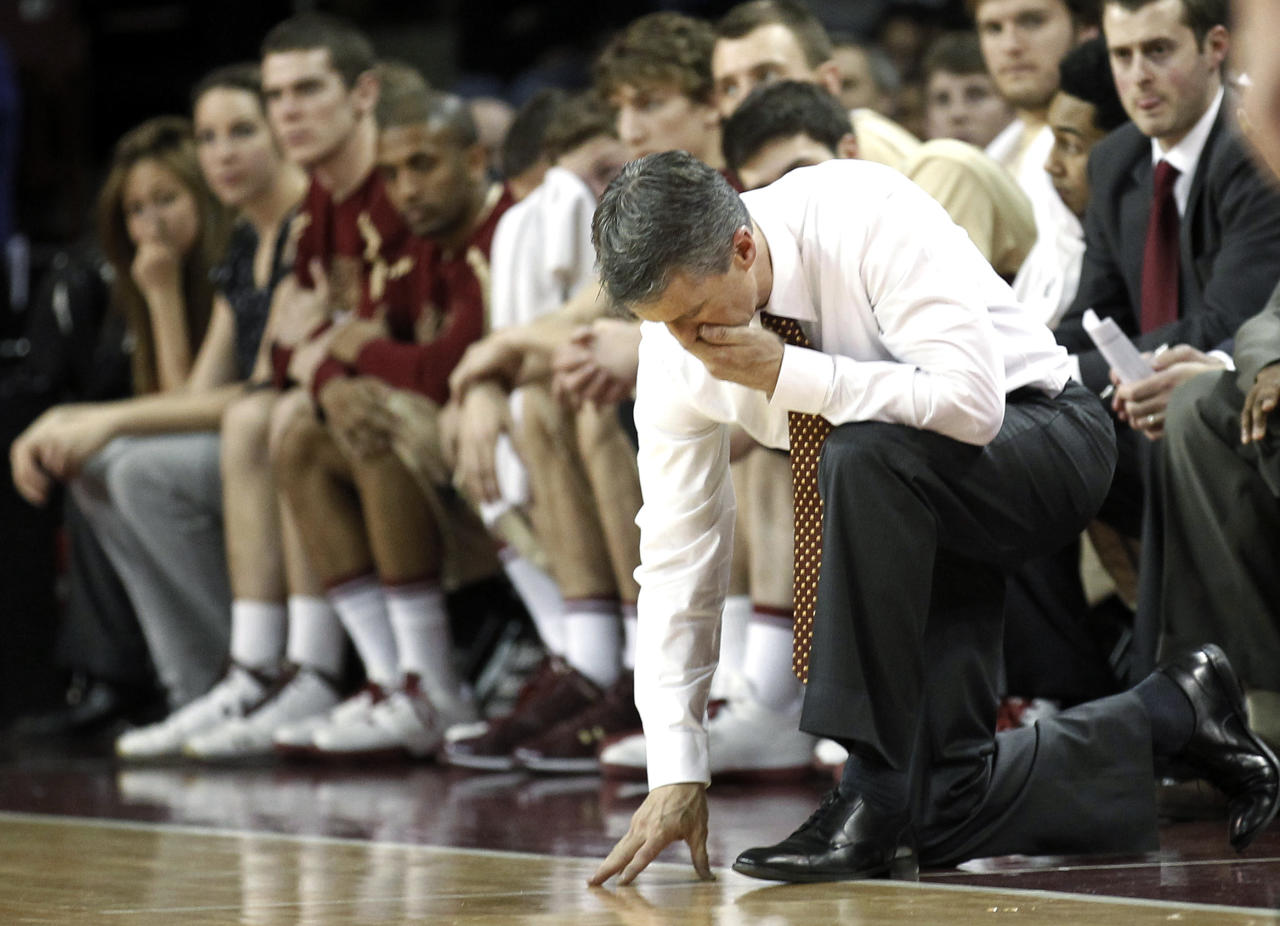 Boston College head coach Steve Donahue drops his head during the second half of their 75-50 loss to Duke in an NCAA college basketball game in Boston, Sunday, Feb. 19, 2012. (AP Photo/Winslow Townson)