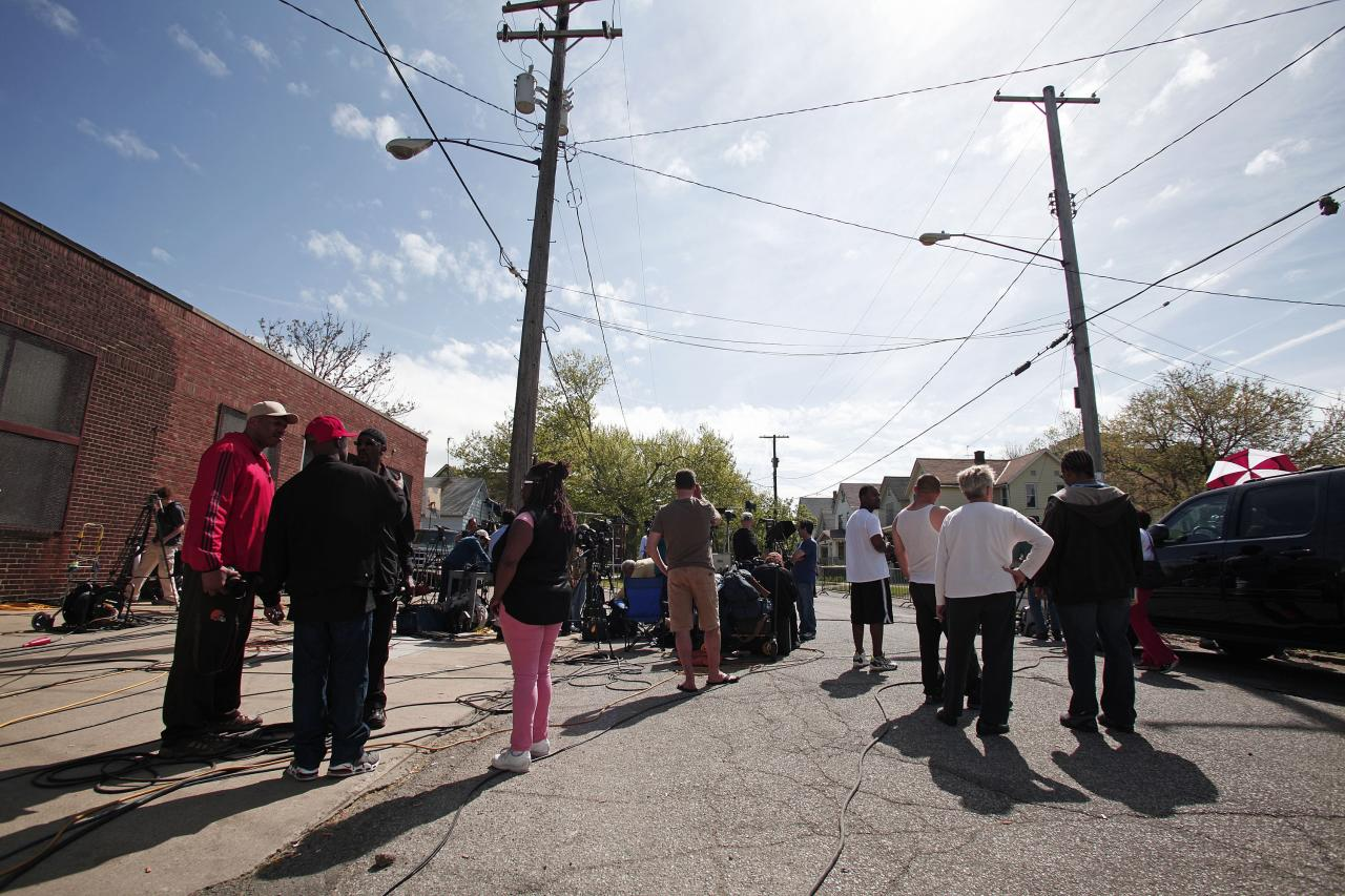 CLEVELAND, OH - MAY 7:  People gather along Seymour Avenue near the house where three women, who disappeared as teens about a decade ago, were found alive May 7, 2013 in Cleveland, Ohio. Amanda Berry, who went missing in 2003, Gina DeJesus, who went missing in 2004, and Michelle Knight, who went missing in 2002, managed to escape their captors on May 6, 2013. Three suspects, all brothers, were taken into custody.   (Photo by Bill Pugliano/Getty Images)