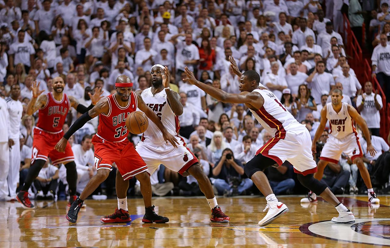 MIAMI, FL - MAY 15:  Richard Hamilton #32 of the Chicago Bulls is guarded by LeBron James #6 and Chris Bosh #1 of the Miami Heat during Game Five of the Eastern Conference Semifinals of the 2013 NBA Playoffs at American Airlines Arena on May 15, 2013 in Miami, Florida. NOTE TO USER: User expressly acknowledges and agrees that, by downloading and or using this photograph, User is consenting to the terms and conditions of the Getty Images License Agreement.  (Photo by Mike Ehrmann/Getty Images)