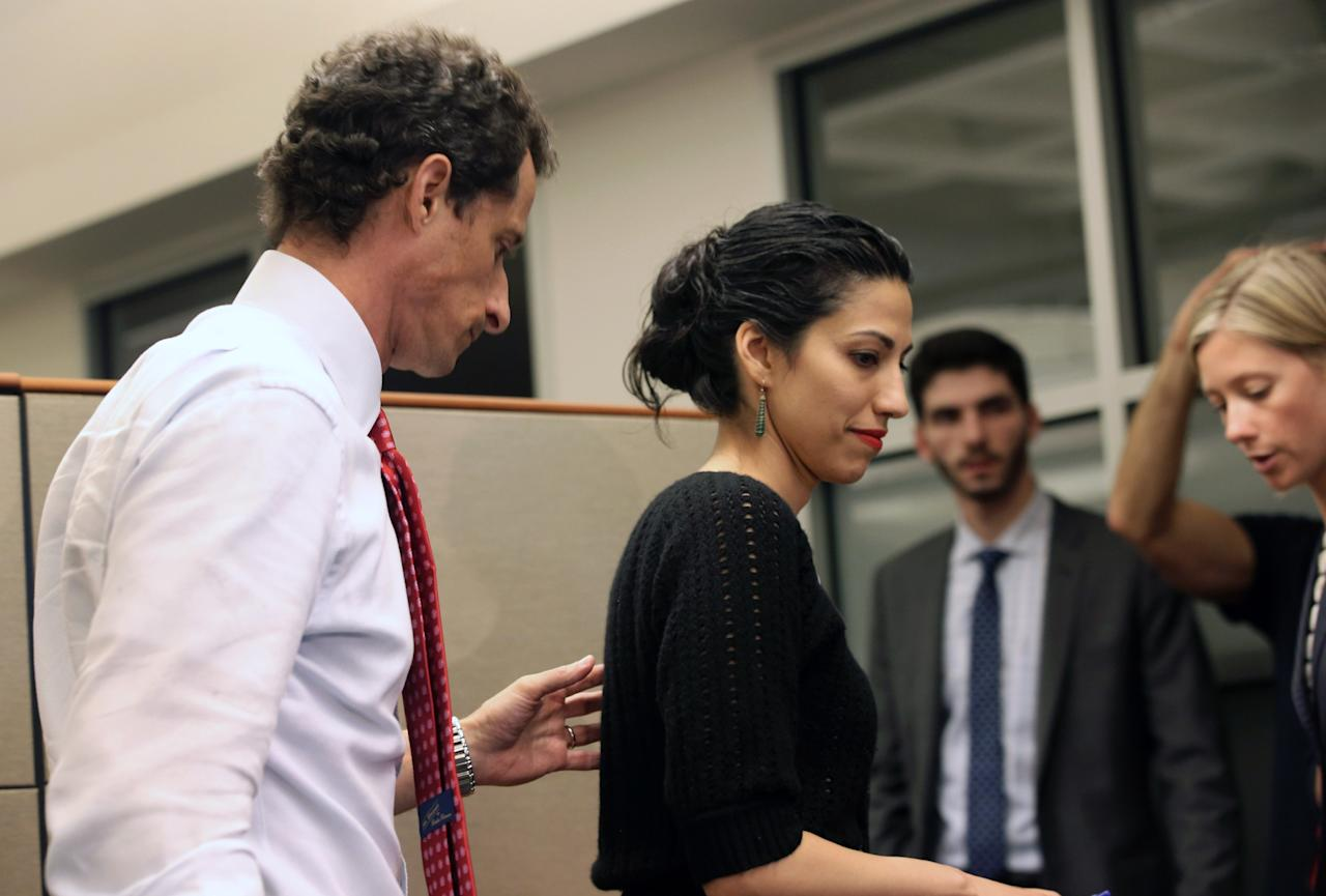 NEW YORK, NY - JULY 23: Anthony Weiner, a leading candidate for New York City mayor, departs with his wife Huma Abedin after a press conference on July 23, 2013 in New York City. Weiner addressed news of new allegations that he engaged in lewd online conversations with a woman after he resigned from Congress for similar previous incidents. (Photo by John Moore/Getty Images)