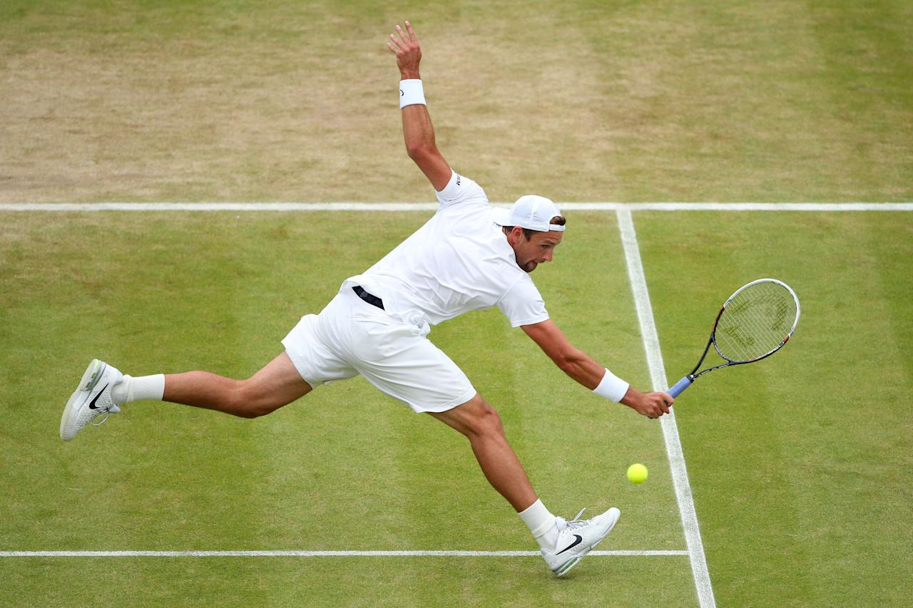 LONDON, ENGLAND - JULY 03: Lukasz Kubot of Poland plays a backhand during the Gentlemen's Singles quarter-final match against Jerzy Janowicz of Poland on day nine of the Wimbledon Lawn Tennis Championships at the All England Lawn Tennis and Croquet Club at Wimbledon on July 3, 2013 in London, England. (Photo by Julian Finney/Getty Images)