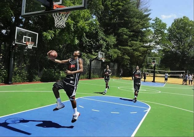 A youth basketball team practices on the new court funded by Steve Francis — The Gazette